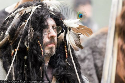 Feathers are wound into the hair to gain mystic insight.